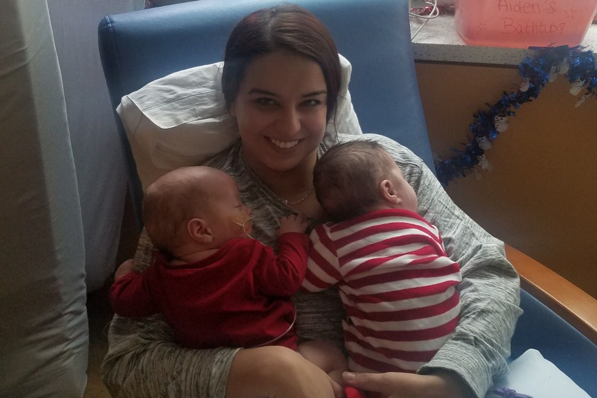 woman with babies in NICU